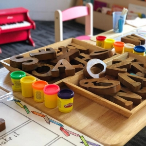 Nursery table with play clay and wooden letters