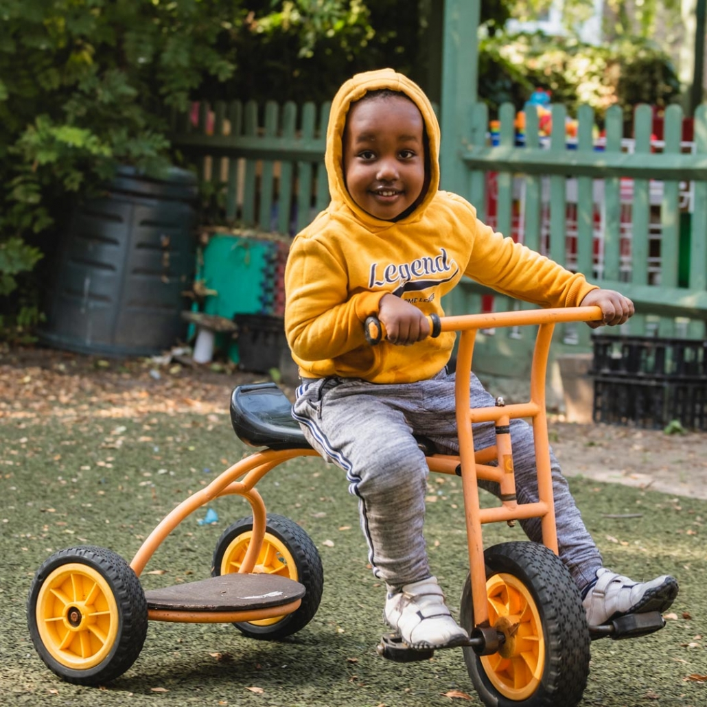 A wonderful tricycle being enjoyed by a young child at Little Cedars Nursery.