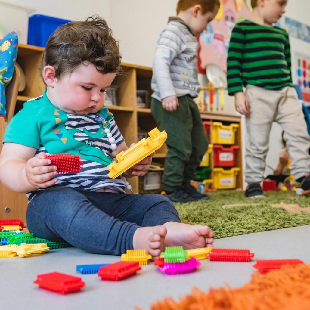 Playing and learning indoors at Little Cedars nursery, London SW16