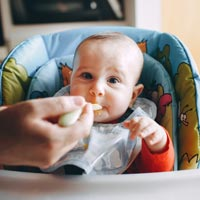 Parents can make the transition to solid foods stress-free and fun if they follow a few simple tips