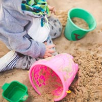 Messy play helps children build strength in their hands, hone motor skills, and improve coordination